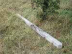 Az Istállós-kői oszlop - eldőlve a fűben